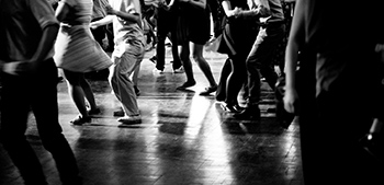 Black and White Bottom View of Many People on the Dance Floor